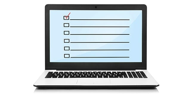 laptop with check box on screen on white background